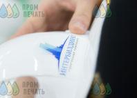 Белые каски с логотипом «ИНТЕРБИЛДИНГ»
