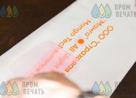 Белая толстовка с надписями «МАНГО», «застрахован»