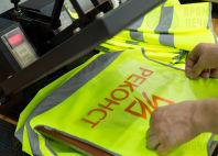 Желтые сигнальные жилеты с логотипом «РЕКОНСТ»